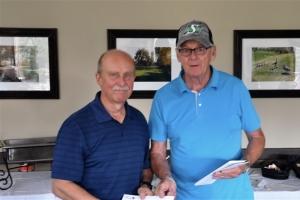 101 Rick K (L) Accepts Team Prize from Bain - Winner Low Score